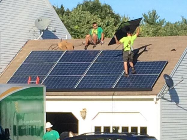 installer walking on his solar panels